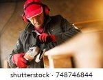 modern senior fabric worker in...   Shutterstock . vector #748746844
