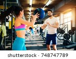 fitness slim girl passing a big ... | Shutterstock . vector #748747789