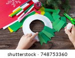 the child glues the details of... | Shutterstock . vector #748753360
