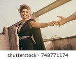 beautiful and elegant woman... | Shutterstock . vector #748771174