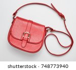 red leather bag on a white...