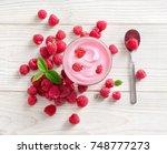 yogurt with fresh raspberry on... | Shutterstock . vector #748777273