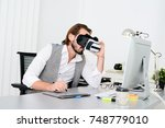 young male software programmer... | Shutterstock . vector #748779010