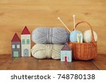 warm and cozy yarn balls of... | Shutterstock . vector #748780138