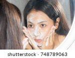 close up woman wash face with... | Shutterstock . vector #748789063
