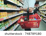a man with a red basket for... | Shutterstock . vector #748789180