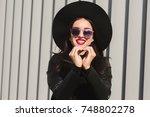 beautiful brunette woman making ... | Shutterstock . vector #748802278