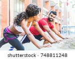 black woman and man doing... | Shutterstock . vector #748811248