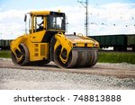 Small photo of A road roller on the road.