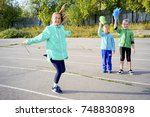 kids on a stadium | Shutterstock . vector #748830898