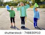 kids on a stadium | Shutterstock . vector #748830910