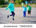 kids on a stadium | Shutterstock . vector #748832830