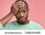 tired dark skinned stylish man... | Shutterstock . vector #748834489