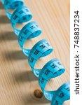 Small photo of Centimeter tape, centimeter, needlework, sewing, fabric, pattern, creativity, diet, measurement, overweight
