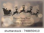santa riding sleigh over... | Shutterstock .eps vector #748850413