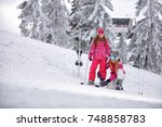 skiing winter time and skiing   ... | Shutterstock . vector #748858783