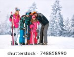 happy family with ski equipment ... | Shutterstock . vector #748858990