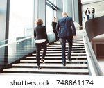 modern business people walking... | Shutterstock . vector #748861174