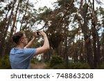 man phone photo forest... | Shutterstock . vector #748863208
