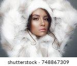 fashion studio portrait of... | Shutterstock . vector #748867309