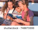 portrait of three preteen...   Shutterstock . vector #748873300