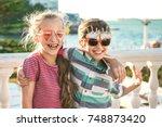 portrait of two preteen... | Shutterstock . vector #748873420