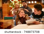 excited girl with boy write... | Shutterstock . vector #748873708