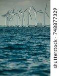 vertical axis wind turbines... | Shutterstock . vector #748877329