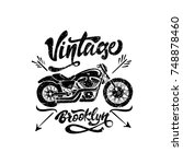 black vintage motorcycle with...   Shutterstock .eps vector #748878460