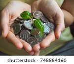 coins of uae. coins and green... | Shutterstock . vector #748884160