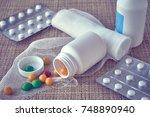 white open medicine bottle and... | Shutterstock . vector #748890940