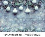 snowy christmas background  fir ... | Shutterstock . vector #748894528