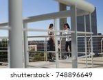 fitness girls stretching leg on ... | Shutterstock . vector #748896649
