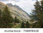 swiss alps mountains under... | Shutterstock . vector #748898428