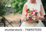 bride with wedding bouquet | Shutterstock . vector #748907050
