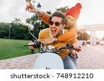 excited man in trendy dark... | Shutterstock . vector #748912210