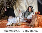 young arab sheik admires the... | Shutterstock . vector #748918096