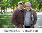 joyful mature best friends...   Shutterstock . vector #748931158