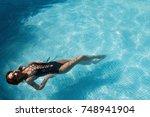 beautiful girl in a swimsuit... | Shutterstock . vector #748941904