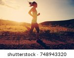 young trail runner woman... | Shutterstock . vector #748943320