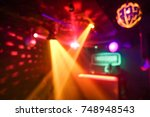 blurred disco club with... | Shutterstock . vector #748948543