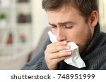 man coughing covering mouth...   Shutterstock . vector #748951999