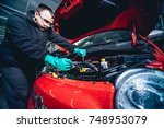 electic car with open hood.... | Shutterstock . vector #748953079