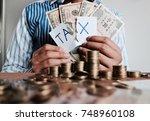 woman in pattern blue shirt's... | Shutterstock . vector #748960108