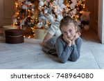 young girl lies near a... | Shutterstock . vector #748964080