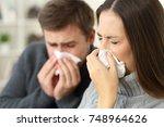 ill couple wearing sweaters... | Shutterstock . vector #748964626
