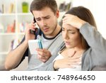 husband calling doctor asking... | Shutterstock . vector #748964650