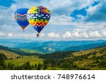 colorful hot air balloons... | Shutterstock . vector #748976614