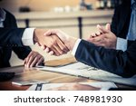 business handshake and teamwork ... | Shutterstock . vector #748981930