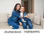 portrait of mother and her son... | Shutterstock . vector #748984993